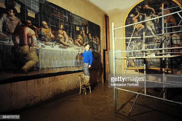 Father Franchi facing the Last Supper by Giorgio Vasari severely damaged during the flood of 1966 Santa Croce Museum Florence 1966