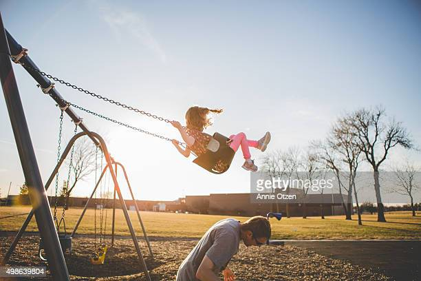 father giving daughter a underdog - swinging stock pictures, royalty-free photos & images
