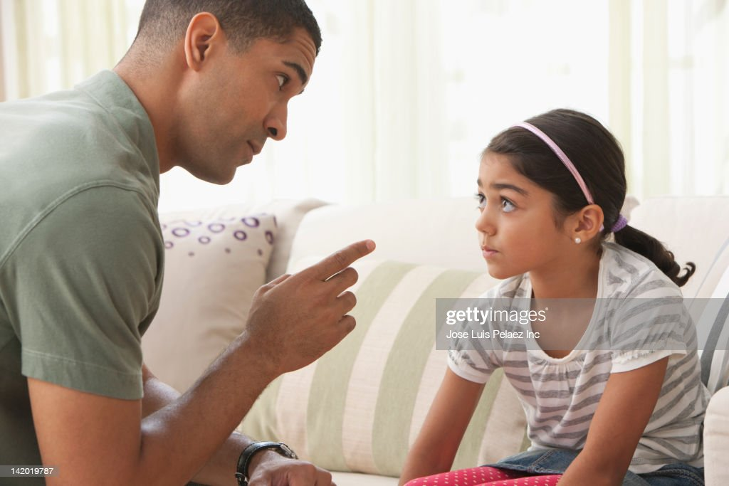 Father giving daughter lecture : Stock Photo