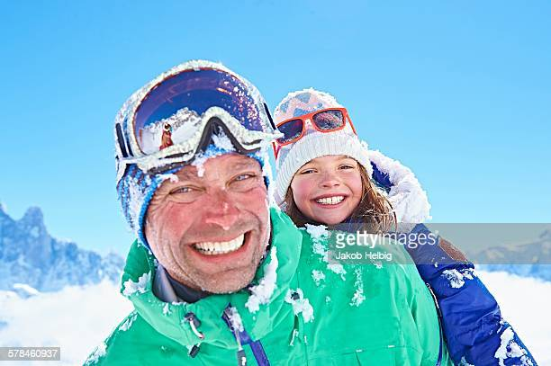 Father giving daughter piggyback ride, Chamonix, France