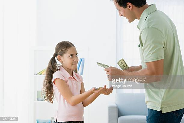 Father giving daughter pocket money