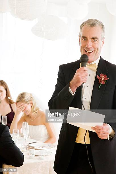 Father giving embarrassing speech at wedding