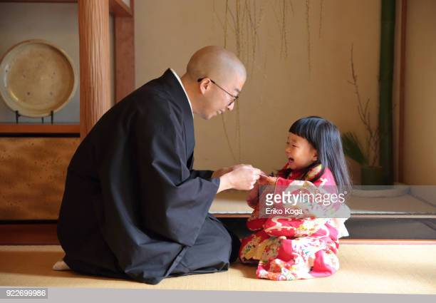 Father giving New Year's gift of money called otoshidama to daughter