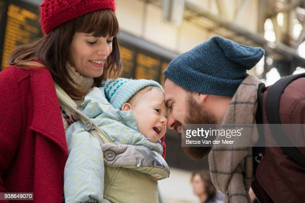 Father greets his baby boy and mother at arrival hall.