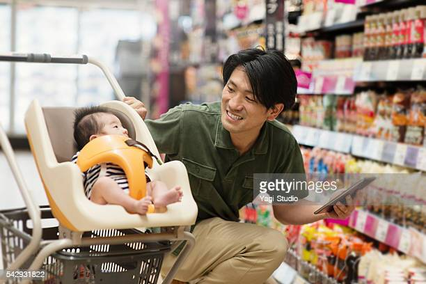 Father grocery shopping at the supermarket