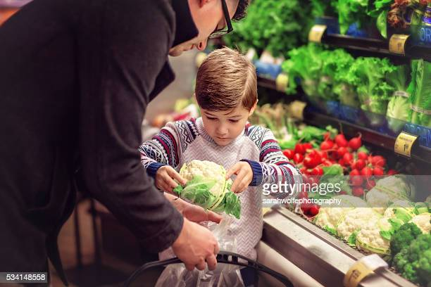 Father Grocery Shopping with son