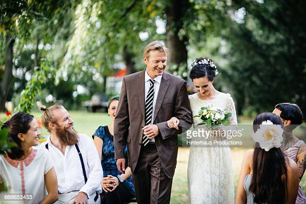 father guiding his daughter to the altar - trouwen stockfoto's en -beelden