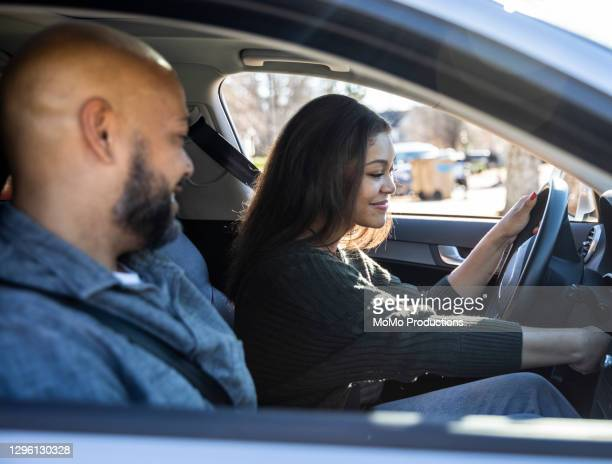 father handing car keys to teenage daughter - daughter stock pictures, royalty-free photos & images