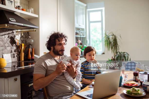 father having breakfast with his kids - genderblend stock pictures, royalty-free photos & images