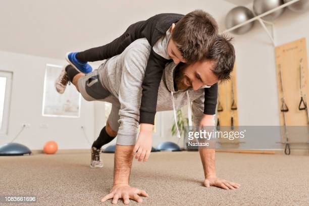 father having fun with son - push ups stock pictures, royalty-free photos & images
