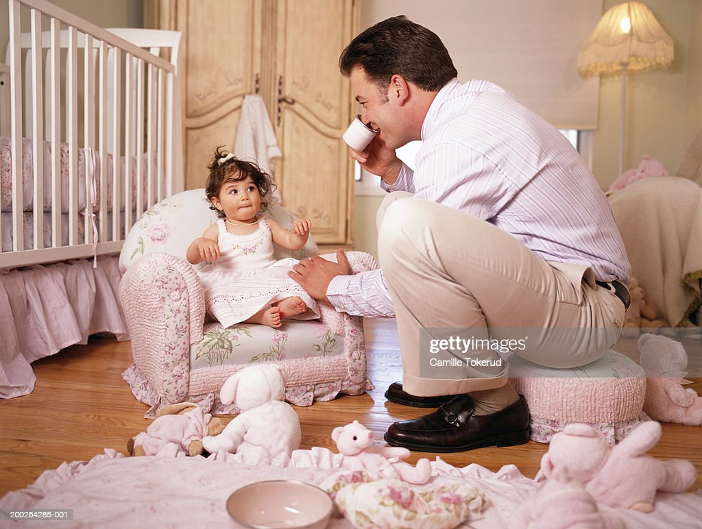 Father Having Tea Party With Baby Girl 9 12 Months Stock Photo