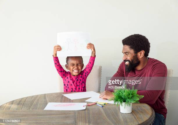 father helping daughter with drawing - prop stock pictures, royalty-free photos & images