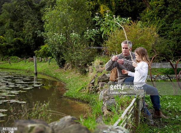 Father helping daughter with her fishing line