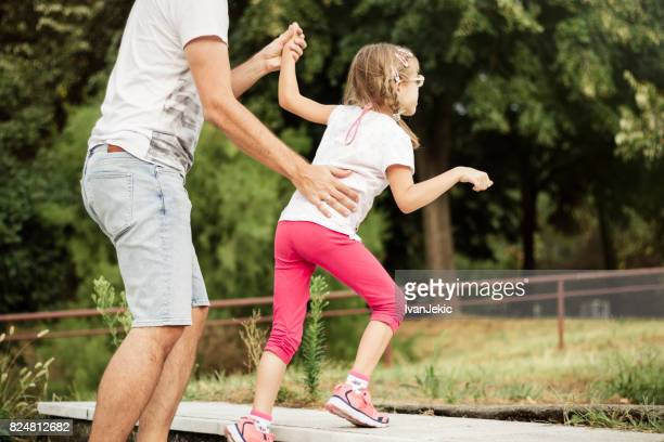 Father helping his daughter with a mild CP to walk up the stairs