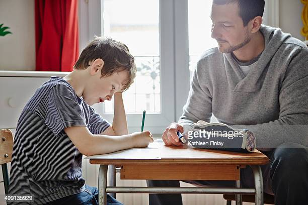 father helping son with homework - pencil case stock photos and pictures