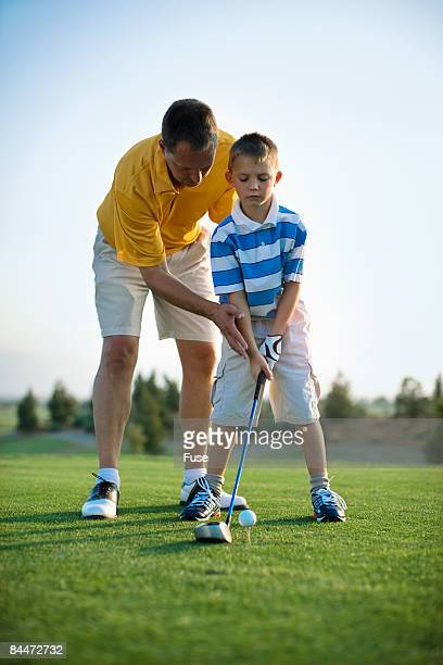 Father Helping Son with Stance