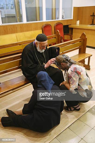 Father Henno Teber blesses women during confession prior to Mass at the St Jacob Syrian Orthodox Antioch Church on Assumption Day on August 15 2014...
