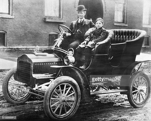 Father Henry and Son Edsel Ford sit in the rare Model F Ford, the second car in production after the Model C.