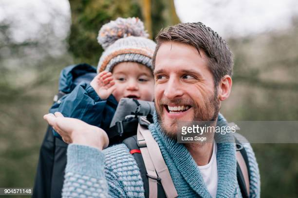 father high-fiving his son whilst on a woodland walk - single father stock pictures, royalty-free photos & images