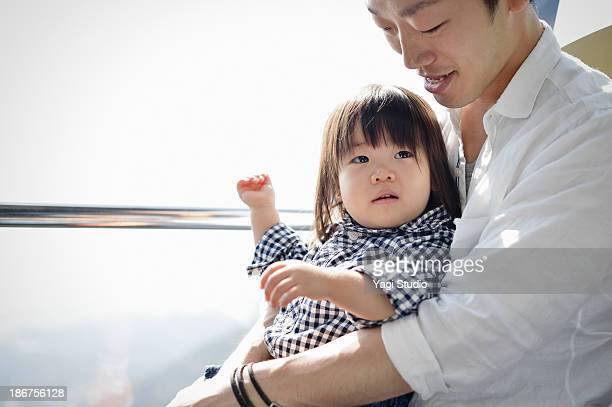 Father holding a daughter