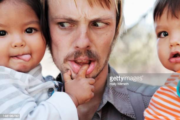 father holding baby boys - san miguel de allende fotografías e imágenes de stock