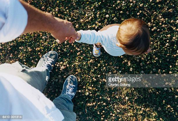 Father Holding Child's Hand