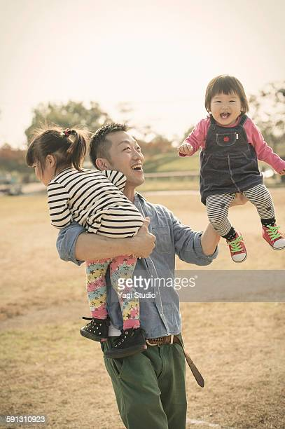 Father holding daughter and enjoying day out