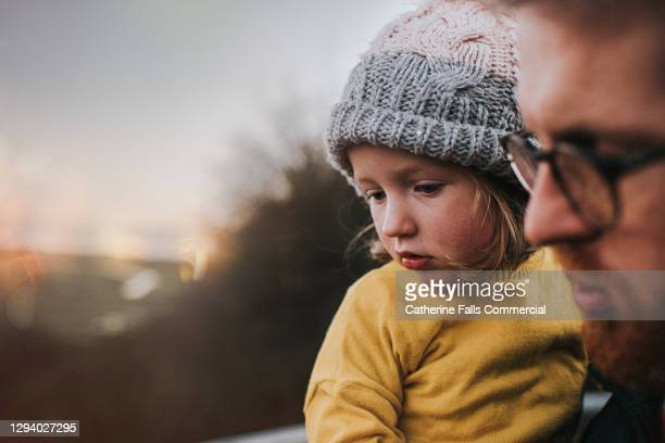 father holding daughter outdoors - genderblend stock pictures, royalty-free photos & images