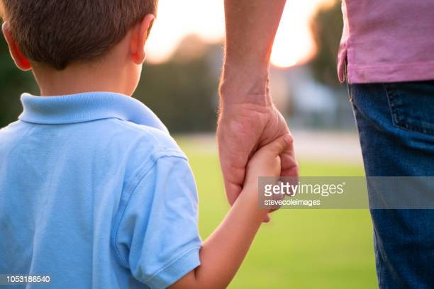 Father Holding Hands with Son