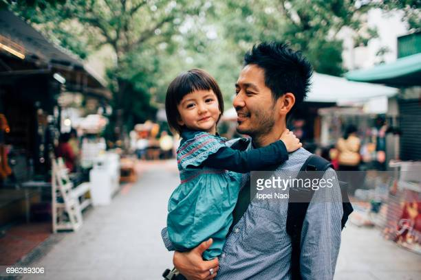 Father holding his adorable mixed race daughter
