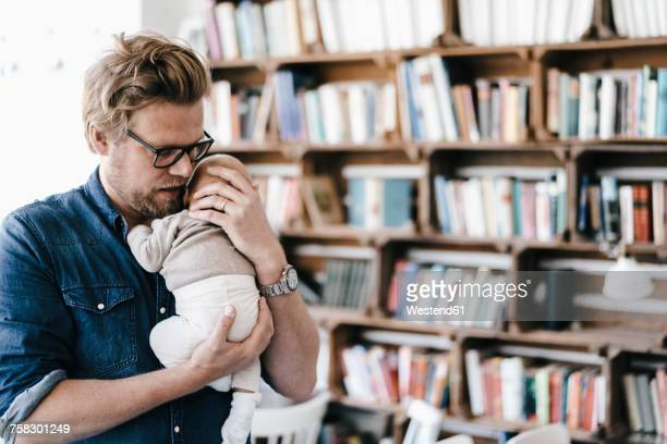 Father holding his baby girl