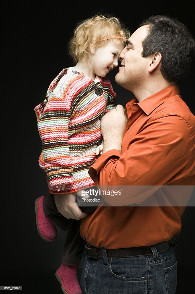 Father holding his daughter : Foto de stock