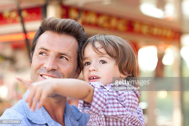 Father holding his son at the carnival