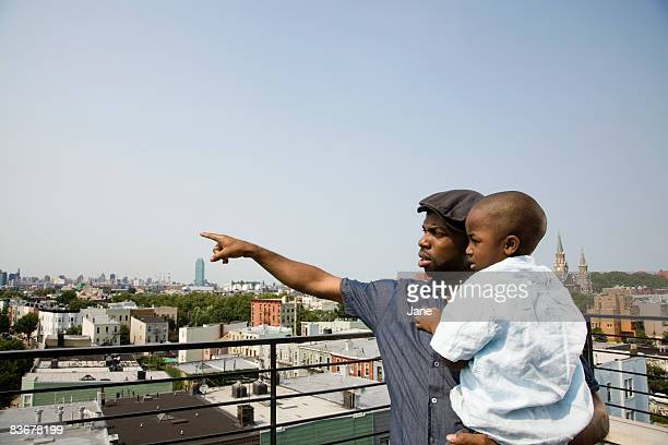 A father holding his son on a balcony