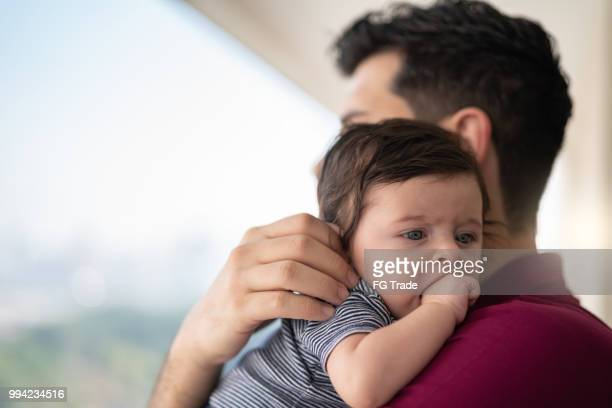 father holding newborn baby son at home - i love you stock pictures, royalty-free photos & images