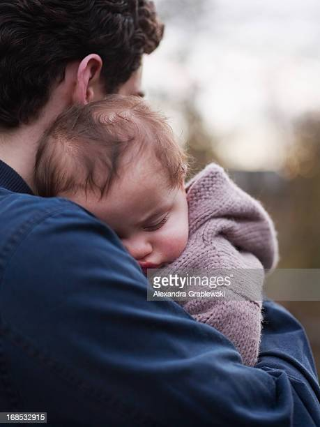 Father Holding Sleeping Baby