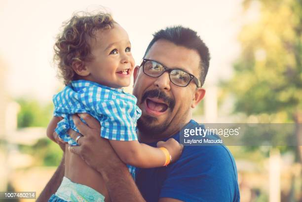 Father Holding Smiling Toddler Son