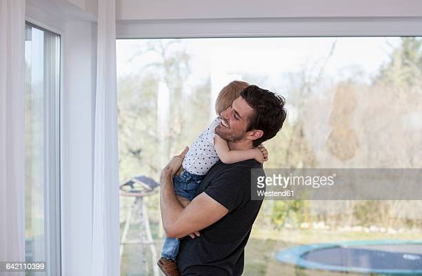 Father holding son in his arms, hugging
