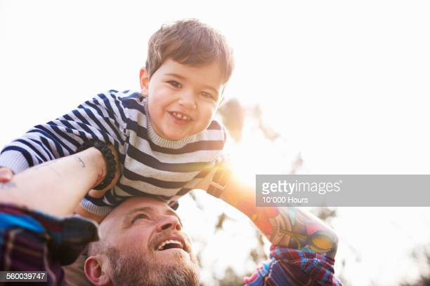 Father holding son in the air