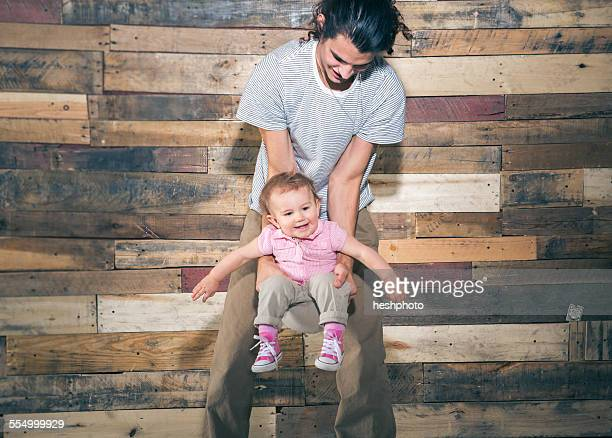 father holding toddler daughter - heshphoto stock pictures, royalty-free photos & images
