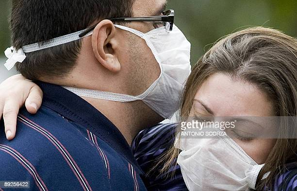 STORY A father holds her daughter as they wait to receive medical attention in Rio de Janeiro on July 23 2009 Authorities said the number of deaths...