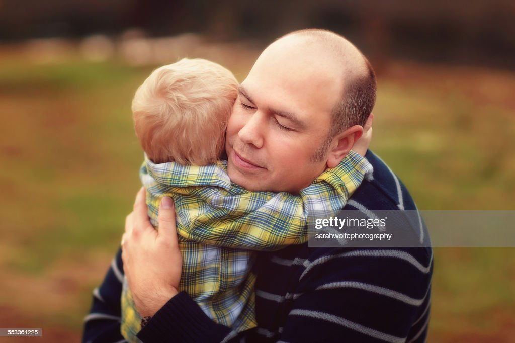 father hugging his two year old son : Stock Photo