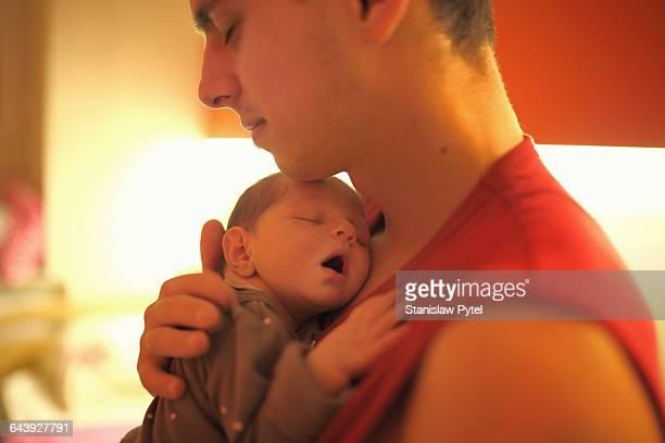 Father hugging newborn