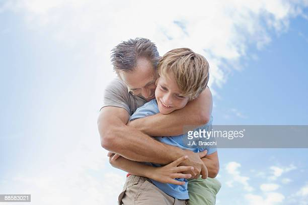Father hugging son
