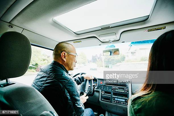 father in discussion with daughter while driving - day in the life stock photos and pictures