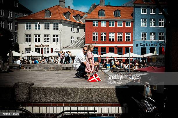 A father instructs his young daughter how to hold the Danish flag before the march begins in Copenhagen Denmark on June 4 2016 The farright group For...