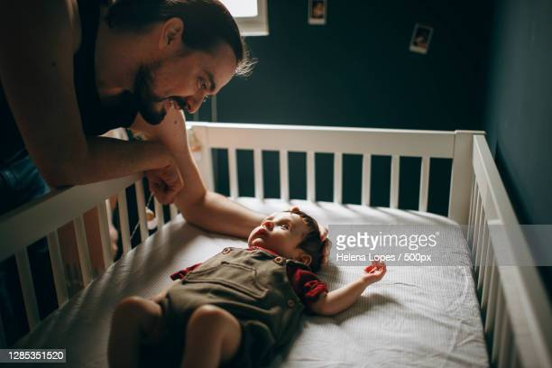 father interacting with his baby boy,belo horizonte,state of minas gerais,brazil - baby stock pictures, royalty-free photos & images