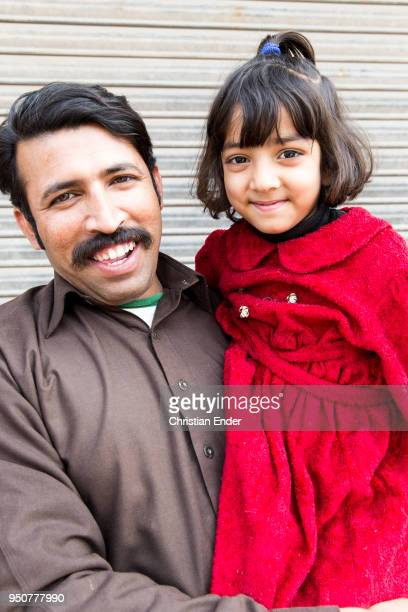 Father is holding his young daughter in his arms on February 27, 2014 in Lahore, Pakistan.