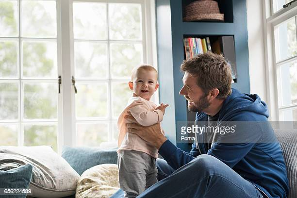 father is spending leisure time with baby boy - leanintogether stock pictures, royalty-free photos & images