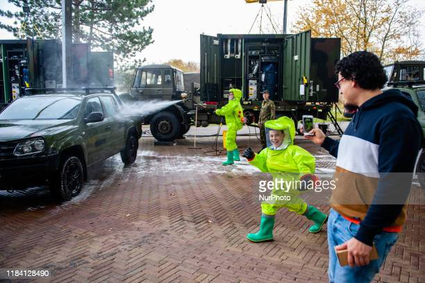 A father is taking a photo of his son wearing a costume during the Bright Day Festival in Amsterdam on November 23rd 2019